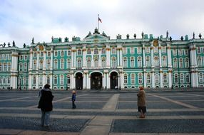 people on square at winter palace, russia, st petersburg