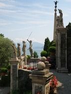 antique sculptures on terrace of palazzo borromeo, italy, Isola Bella
