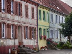 old colorful buildings side by side, france, alsace