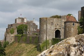 medieval dover castle on cliff at cloudy sky, uk, england