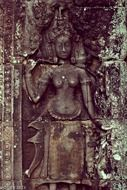 stone carved female figure on wall of ancient khmer temple, cambodia, angkor thom