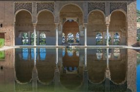 Reflection in the water of a mosque in Granada, Spain