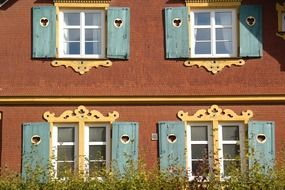 house windows with carved shutters