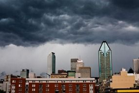 scenic stormy clouds above city, canada, montreal