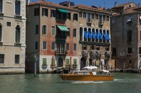 motor boat on grand canal in city, italy, venice