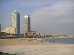 people on sea beach at city, spain, barcelona