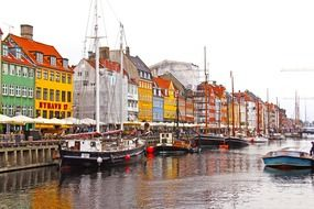 sailing boats on water at colourful houses, denmark, copenhagen, nyhavn