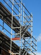 Scaffolding against the blue sky