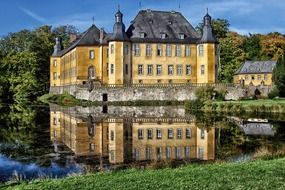 Reflection of yellow Dyck Castle in Juchen
