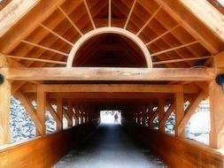perspective of wooden covered bridge, canada, british columbia