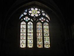 colorful stained glass lattice window in church