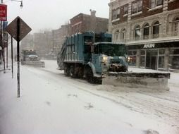 snowplow at work on street, usa, illinois, chicago