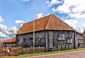 weathered wooden building of shop in countryside, netherlands