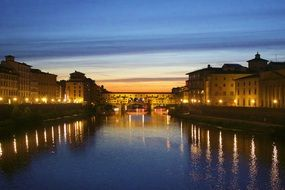 distant view of ponte vecchio at dusk, italy, florence