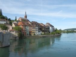 row of picturesque old houses at rhine river, switzerland, laufenburg