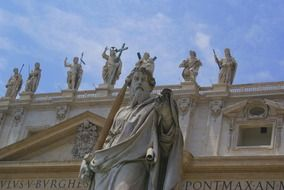 Statue of Saint Paul with façade of St Peter's Basilica, italy, rome, vatican