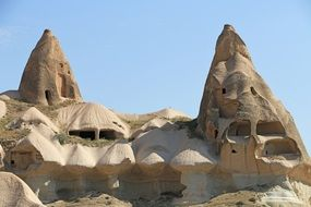 fairy towers of rock dwelling at sky, turkey, cappadocia