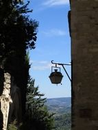 old street lantern on wall at idyll landscape, france, provence