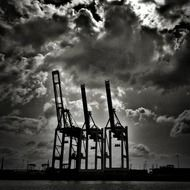 Container cranes in port at sky, germany, hamburg