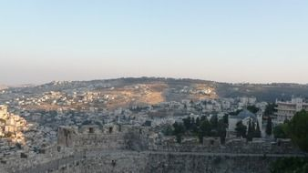 city behind wall at sunrise, israel, jerusalem