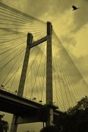 part of suspension bridge at cloudy sky