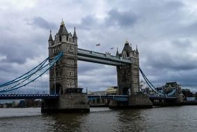 combined bascule and suspension tower bridge across thames river, uk, england, london