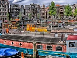boats and ships at harbour in old city, netherlands, amsterdam
