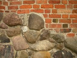 wild stone and red brick wall of medieval castle, detail