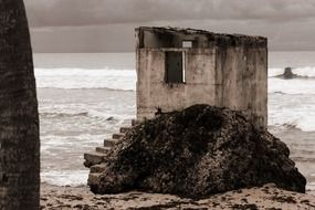 ruined cabin at stormy sea