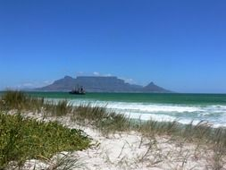sand dunes at sea in view of distant table mountain, south africa, cape town, Bloubergstrand