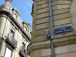 place camille jullian, street name sign on old building in city, france, bordeaux