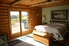 bedroom at log house interior