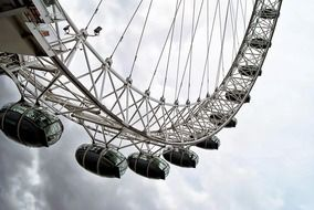 london eye ferris wheel at clouds, fragment, uk, england