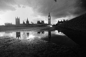 distant view of big ben tower and westminster palace in rainy weather, uk, england, london