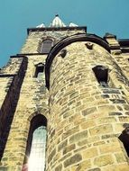low angle view of medieval church tower at sky, germany