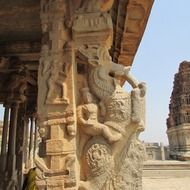 horse rider, ancient stone sculpture on pillar of temple, india, hampi