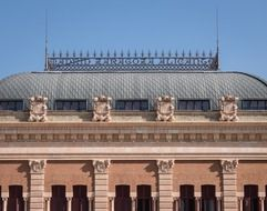 roof of atocha railway station building at sky, spain, madrid