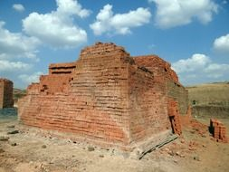 pile of red bricks in countryside, india, dharwad