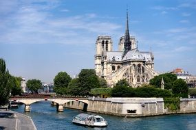tourist boat on seine river at notre dame cathedral, france, paris