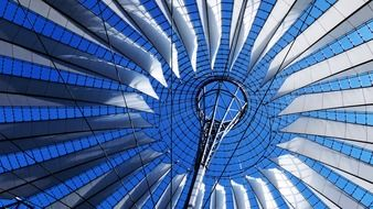 bottom view of glass and metal roof construction of sony center, germany, berlin