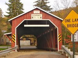 wooden covered bridge in countryside, usa, pennsylvania
