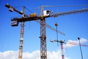 cranes load lifter in the sky with white clouds