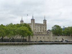view of Tower of London from thames river, uk, england