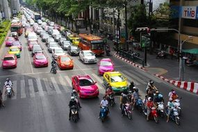 colorful cars and scooters on road in city, thailand, bangkok