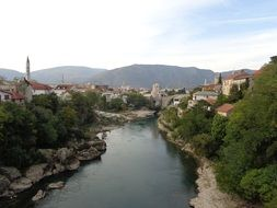 beautiful old town on both sides of river at mountains, bosnia and herzegovina, mostar