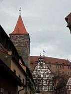 medieval tower and truss building of imperial castle, germany, nuremberg