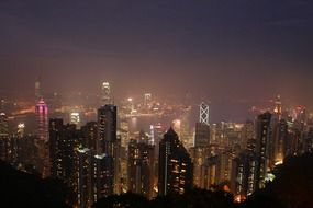 top view of night city in fog, china, hong kong