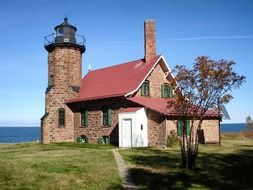 sand island lighthouse, brick building at sea, usa, wisconsin