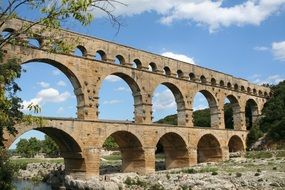 Pont du Gard, ancient roman Aqueduct bridge in countryside at summer, france, provence
