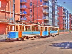 colorful vintage tram at apartment buildings, sweden